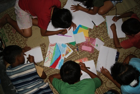 Drawing at the village head's house in Sumber